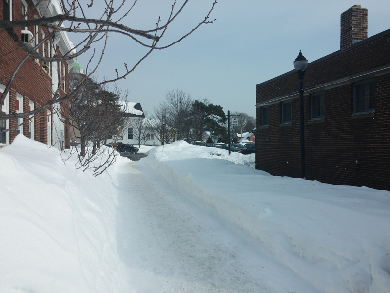 This is normally a brick walkway to the municipal lot in downtown Needham.