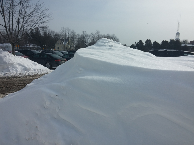 A snow bank in the parking lot. What is difficult to see here , is the bank is easily 2' taller than me.