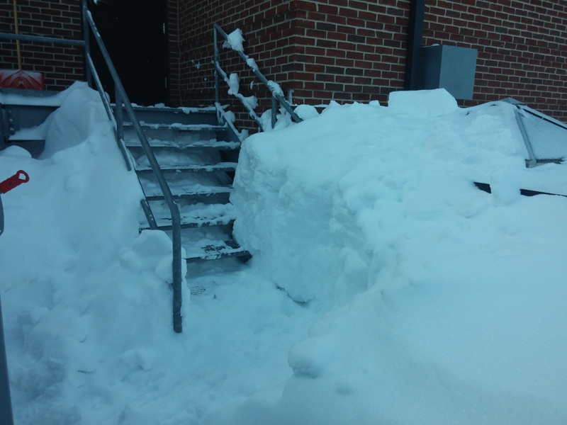 Here is the trench we dug in the snow to get on to the roof!