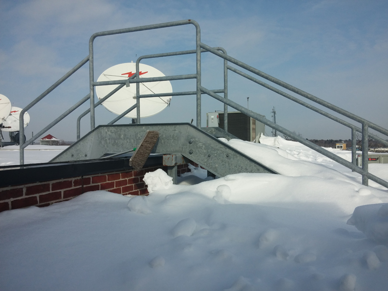 Here is another excellent view of the 5' snow drifts on the roof. The steel side of these stairs on top, is the height of my face.