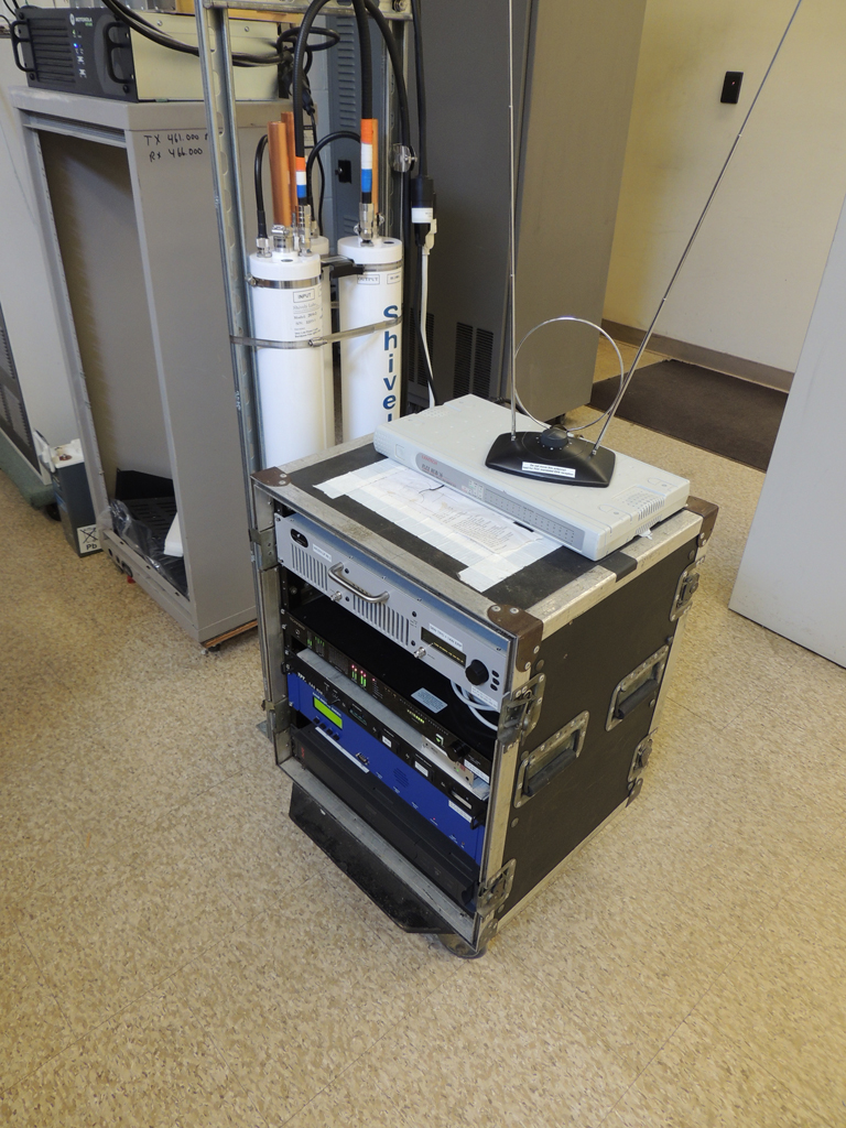 The tiny transmitter rack. Not much needed. Behind the rack is a Shively Labs bandpass filter, as required by the tower owner.