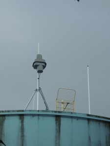 WVAO-LP's single bay Shively 6812 antenna and STL dish on the High Knob water tank.