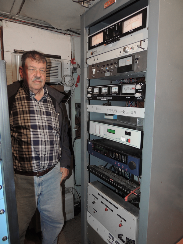 Doug standing next to the WMRC processing gear at the transmitter.